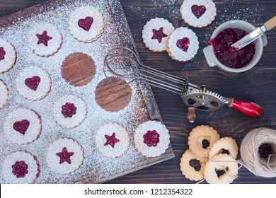 Linzer Cristmas cookies with jam and powder sugar flat lay and copy space. Creative concept.