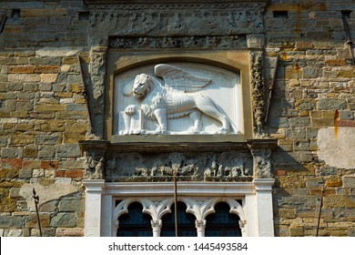 Lion Chimera bas-relief on the old twon building in Bergamo, Italy