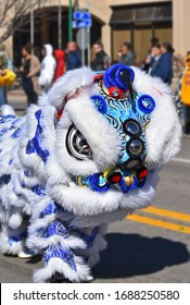 Lion dance, blue and white lion in a parade