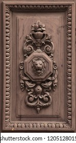 Lion depicted in the wooden relief on the door of the dwelling house in Prague, Czech Republic.