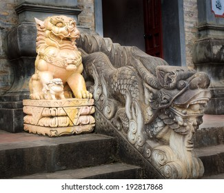 Lion and dragon statue at the door of temple