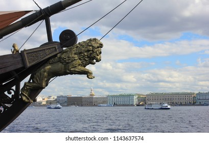 Lion Figurehead at the Prow of Old Vintage Ship Moored in Saint Petersburg, Russia. Carved Figurehead Decoration with Lion Sculpture on Cloudy Sky Background. Naval and Marine Old Ship Details.