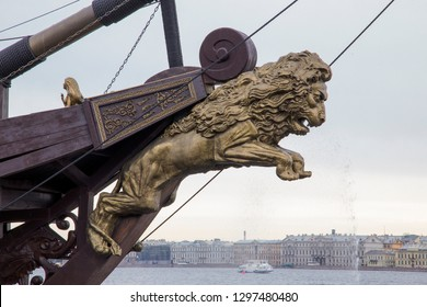 Lion Figurehead at the Prow of Old Vintage Ship Moored in Saint Petersburg. Carved Figurehead Decoration with Lion Sculpture on Cloudy Sky Background. Saint Petersburge, Russia - September 17, 2018.