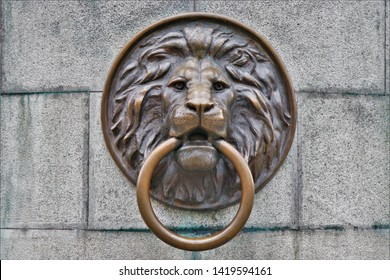 Lion head door knocker, located in the city center of Odessa, Ukraine. June 2019.