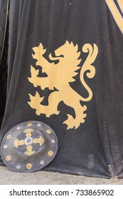 Lion, medieval tent of different colors with coats of arms and blazons of noble houses