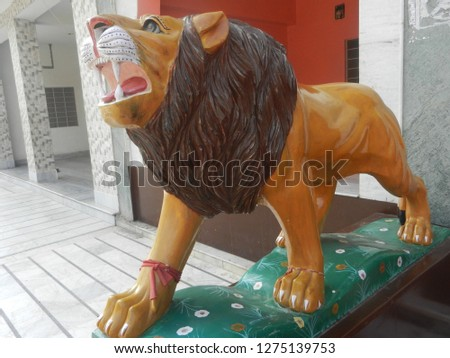 lion with open mouth, made up of clay