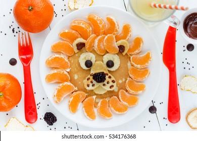 Lion pancakes - funny breakfast idea for kids, food art composition