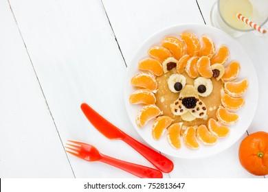 Lion pancakes with tangerines, breakfast food art