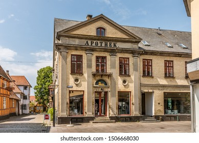 Lion Pharmacy with an ancient greek facade with columns in ionic order, Faaborg, Denmark, July 12, 2019