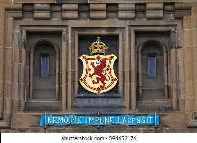 The Lion Rampant crest above the main entrance of Edinburgh Castle in Scotland.