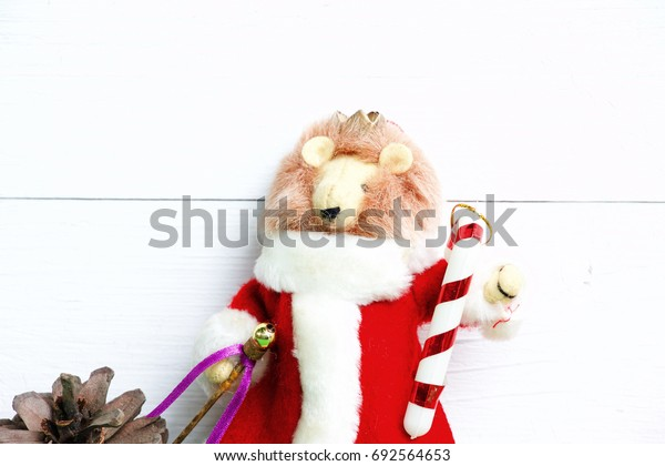 Lion Santa with pine on white background