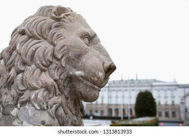 Lion sculpture in front of President Palace in Warsaw (Warszawa). Old, rebuilt architecture in the old town.