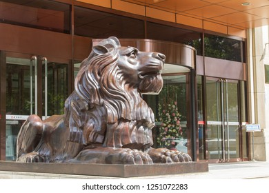 lion statue at the entrance to a modern building in the Chinese city of Dalian. Travel in China. Dalian, China - august 12, 2018