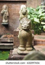 The lion statue is in the garden.