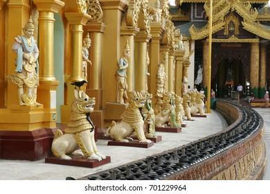 Lion Statue in Great Golden Pagoda, Yangon, Landmark of Burma, the most sacred Buddhist pagoda in Myanmar