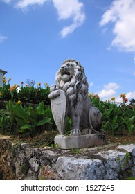 A lion statue at a Jamaican plantation estate.