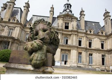 Lion statue near abandoned castle, France