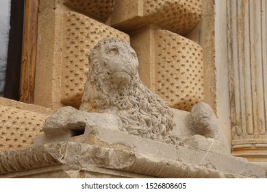 Lion statue on palace wall in the Alhambra Palace, Grenada, Spain