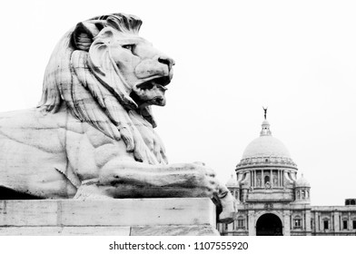 the lion statue at the victoria memorial in kolkata as black and white picture