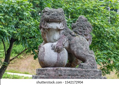 Lion-dog, or komainu, at MIkami Shinto shrine near Kanazawa, Japan. These ancient traditional statues are seen in pairs in most shrines and are intended to ward off evil spirits.