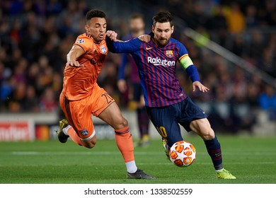 Lionel Messi of Barcelona and Fernando Marcal during the UEFA Champions League Round of 16 Second Leg match between FC Barcelona and Olympique Lyonnais at Nou Camp on March 13, 2019 in Barcelona, Spai