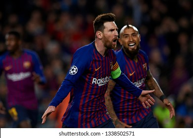 Lionel Messi of Barcelona whit Arturo Vidal during the UEFA Champions League Round of 16 Second Leg match between FC Barcelona and Olympique Lyonnais at Nou Camp on March 13, 2019 in Barcelona, Spain.