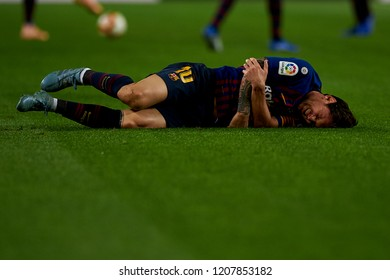 Lionel Messi lies injured on the pitch during the week 9 of La Liga match between FC Barcelona and Sevilla FC at Camp Nou Stadium in Barcelona, Spain on October 20, 2018.