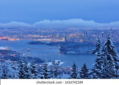 Lions Gate Bridge and Downtown Vancouver in winter with snow, viewed from Cypress Mountain