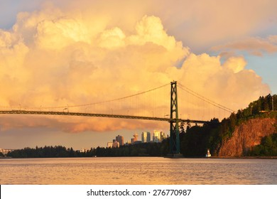 Lions Gate Bridge and Downtown Vancouver with spectacular clouds at sunset, from Ambleside Park in West Vancouver