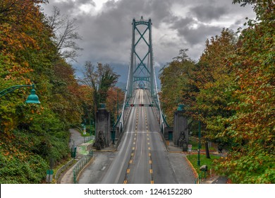 Lions Gate Bridge as seen from Stanley Park in  Vancouver, Canada with autumn leaves. The Lions Gate Bridge, opened in 1938, officially known as the First Narrows Bridge, is a suspension bridge.