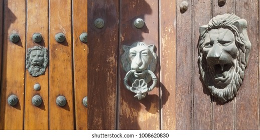 Lion's head door knocker representing a military household  in old town colonial Cartagena, Colombia