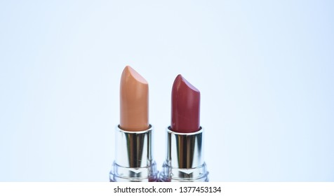 Lip care concept. Lipsticks on white background. High quality lipstick. Daily make up. Cosmetics artistry. Lipstick for professional make up. Pick color which suits you. Compare makeup products.