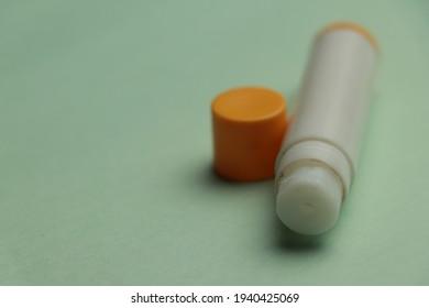 Lip Gel Closeup Photo Orange Color cap White body gel bum for lip stock lip bum