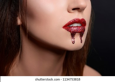 lip vampire make-up red lipstick flowing blood make-up on halloween red lips beauty photo lips with sparkles