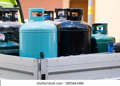 LIPARI, ITALY - August 7, 2019. Delivery of gas cylinders. Truck delivered propane cylinders. Apecar loaded with gas cylinders. Many gas tanks.