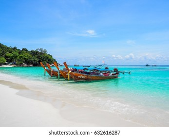 LIPE ISLAND, THAILAND - APRIL 16, 2017 :  Fishing boat parked on the beach after take tourists snorkeling
