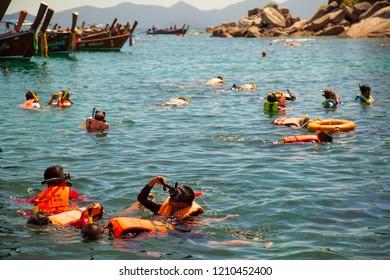LIPE, THAILAND - MARCH 19, 2018: Tourist snorkeling in Andaman sea around Lipe Island, Thailand