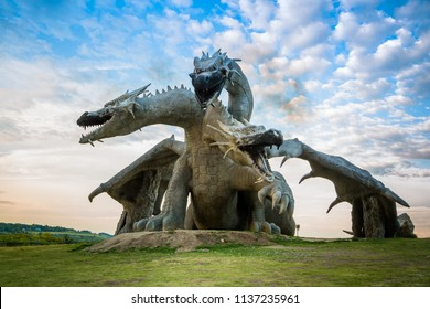 Lipetsk region, Eletz, Russia 2018: Dragon. Huge sculpture of three-headed dragon. Safari park. Ethno folk festival at Kudykina Mountain.