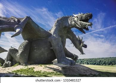 Lipetsk region, Russia - June 6, 2018: Family Ethnic Amusement Park Kudykina Gora (Kudykina mountain). Monument of Russian fairytale three-headed dragon Zmey Gorynych.