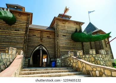 Lipetsk region, Russia - May 8, 2018: Entrance at wooden fortress with fabled towers. Family Ethnic Amusement Park Kudykina Gora (Kudykina mountain).