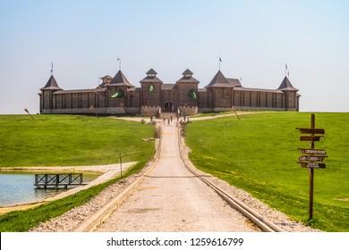 Lipetsk region, Russia - May 8, 2018: Family Ethnic Amusement Park Kudykina Gora (Kudykina mountain). Way to fairy wooden fortress.