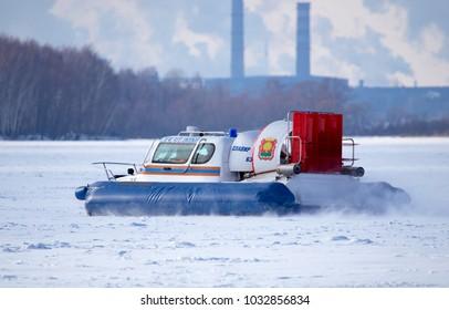 LIPETSK, RUSSIA - February 23, 2018: Rescuers on an air-cushion boat patrolling the lake