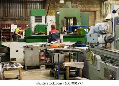 LIPETSK, RUSSIA - JUNE 15, 2017: Lipetsk Machine Tool Plant, team of turners works behind lathes.