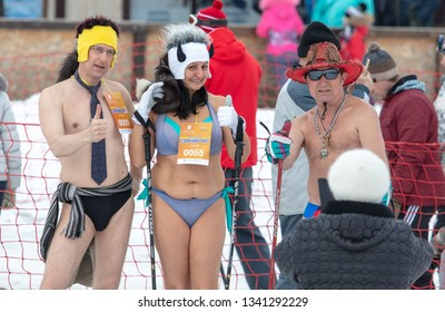 Lipetsk, Russia - March 17, 2019: People in bathing suits ski in the snow.