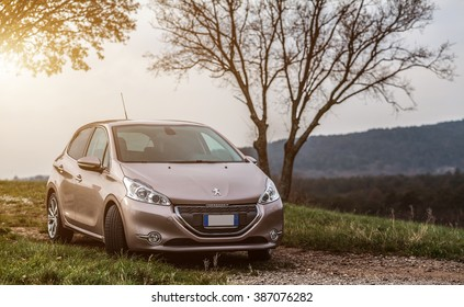 LIPIZA , SLOVENIA DECEMBER 08, 2013: Photo of a Peugeot 208 E-hdi  .The Peugeot 208 is a supermini car produced by the French automaker Peugeot and unveiled at the Geneva Motor Show in March 2012.