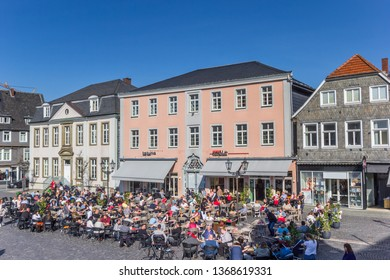 LIPPSTADT, GERMANY - MARCH 22, 2019: People enjoying the sun at the market square in Lippstadt, Germany