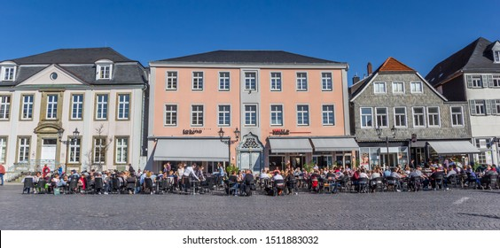 LIPPSTADT, GERMANY - MARCH 22, 2019: Panorama of people sitting and drinking on the central square of Lippstadt, Germany