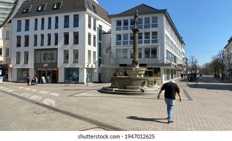 Lippstadt, NRW, Germany- 03.31.2021: A man walks through an empty pedestrian zone