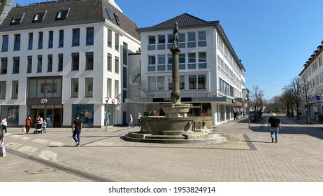 Lippstadt, NRW, Germany- 03.31.2021: People walk in the downtown of Lippstadt