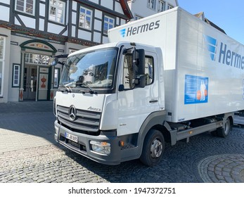 Lippstadt, NRW, Germany- 03.31.2021: A truck from the logistics company Hermes is in front of a shop